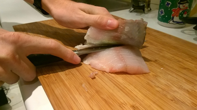 Use a sharp knife and lead it all the way down along the skin.