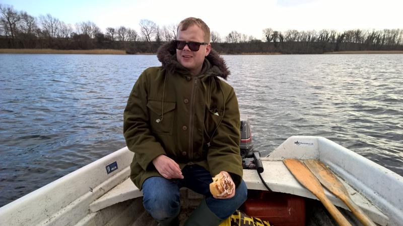 Morten eating cinnamon buns